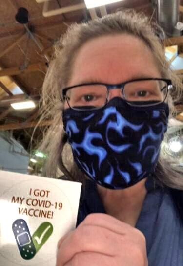 Sherri Haight shows her vaccine sticker